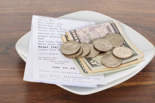 notes and coins - a check stub generator can help you calculate tips more accurately